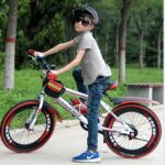 Image of 10 year old kid on bike