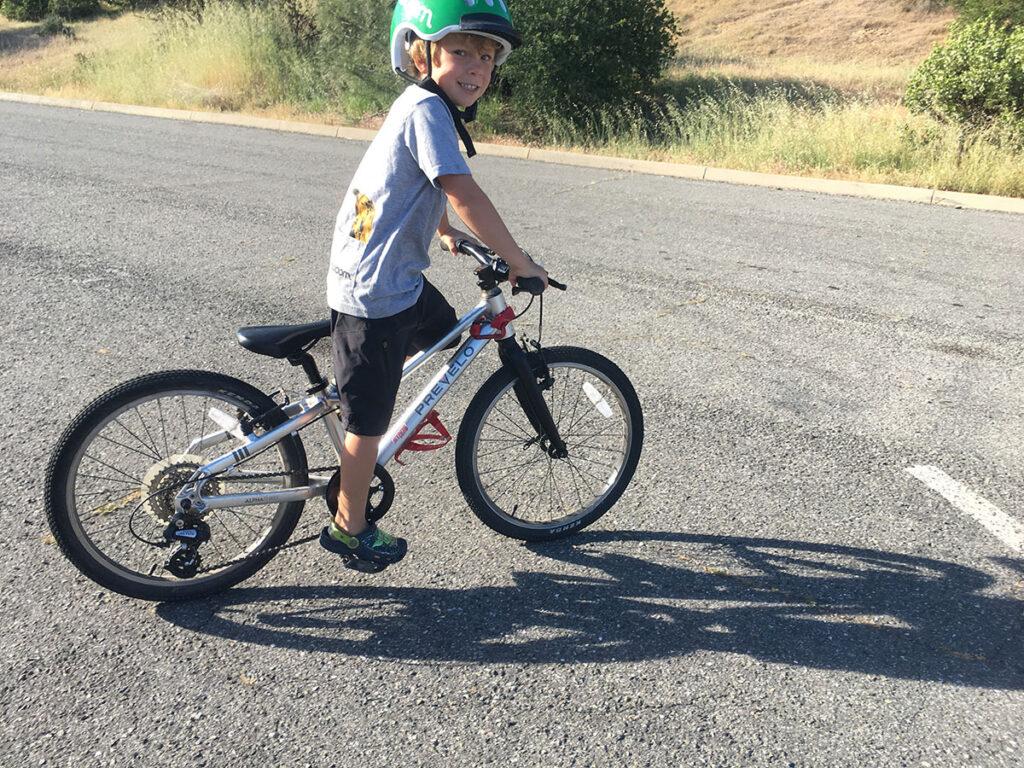 Image of 8 year old kid on bike